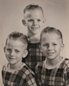 Catholic school pictures, clockwise, Stephen, Michael, and Dennis.